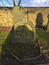 The grave of Edward Ormerod. The foot stone shows the 'Ormerod safety link' (a detachable hook on cages) which Edward designed and patented and it transformed safety in the mines. (Source: Own Photograph, 2016)