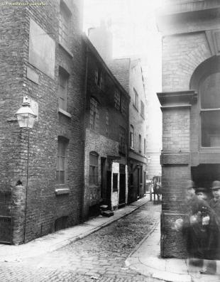 A photograph taken in 1892 showing the corner of Union Street and the little alley running off it known as Church Lane. I love this photograph because the man and woman walked into the shot mid-exposure, so they appear twice. However because they were moving there is a translucent, ghost-like quality to their image. (Source: M01696, E. Ireland, 1892, http://images.manchester.gov.uk/index.php?session=pass)